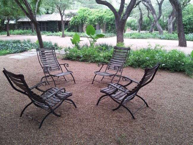crushed granite area with chairs and foliage