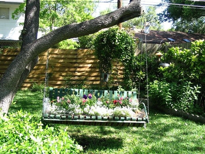Flower Swing hanging from branches, | SAWS Garden Style Conservation Water Saver San Antonio Texas