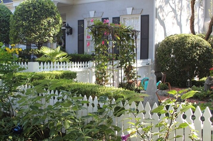 white picket fence with trellis