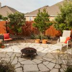 Large flagstone patio with a fire bowl to relax around.