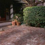 A brick patio assembled by hand (without mortar) is a craft.
